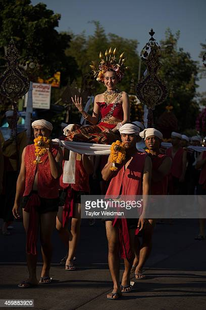 Traditionally dressed Thai residents take part in a parade in honor of the King's birthday on December 3 2014 in Chiang Mai Thailand December 5th...
