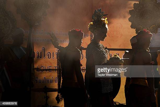 Traditionally dressed Thais and foreigners take part in a parade and ceremony in honor of the King's birthday on December 3 2014 in Chiang Mai...