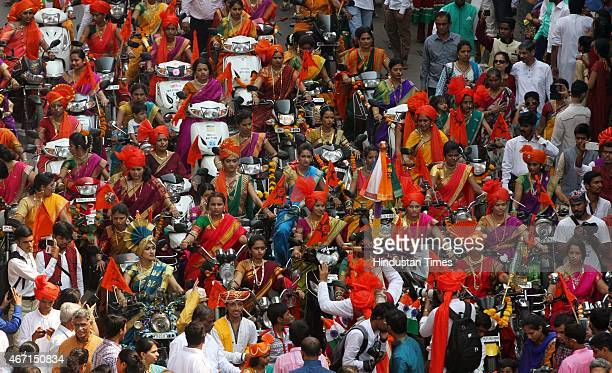 Traditionally dressed women taking part in procession on motorbikes on the occasion of Gudi Padwa Marathi New year at Charni Road on March 21 2015 in...