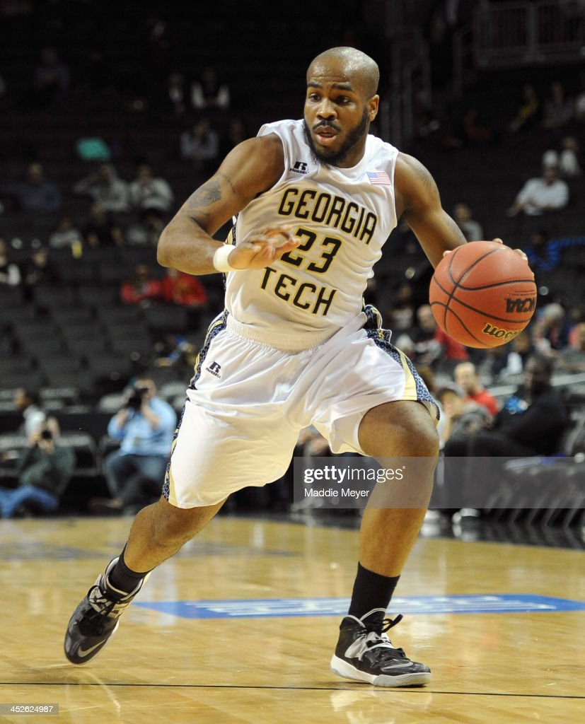 <a gi-track='captionPersonalityLinkClicked' href=/galleries/search?phrase=Trae+Golden&family=editorial&specificpeople=7360099 ng-click='$event.stopPropagation()'>Trae Golden</a> #23 of the Georgia Tech Yellow Jackets dribbles against the St. John's Red Storm during their consolation game of the Barclays Center Classic at Barclays Center on November 30, 2013 in the Brooklyn borough of New York City.