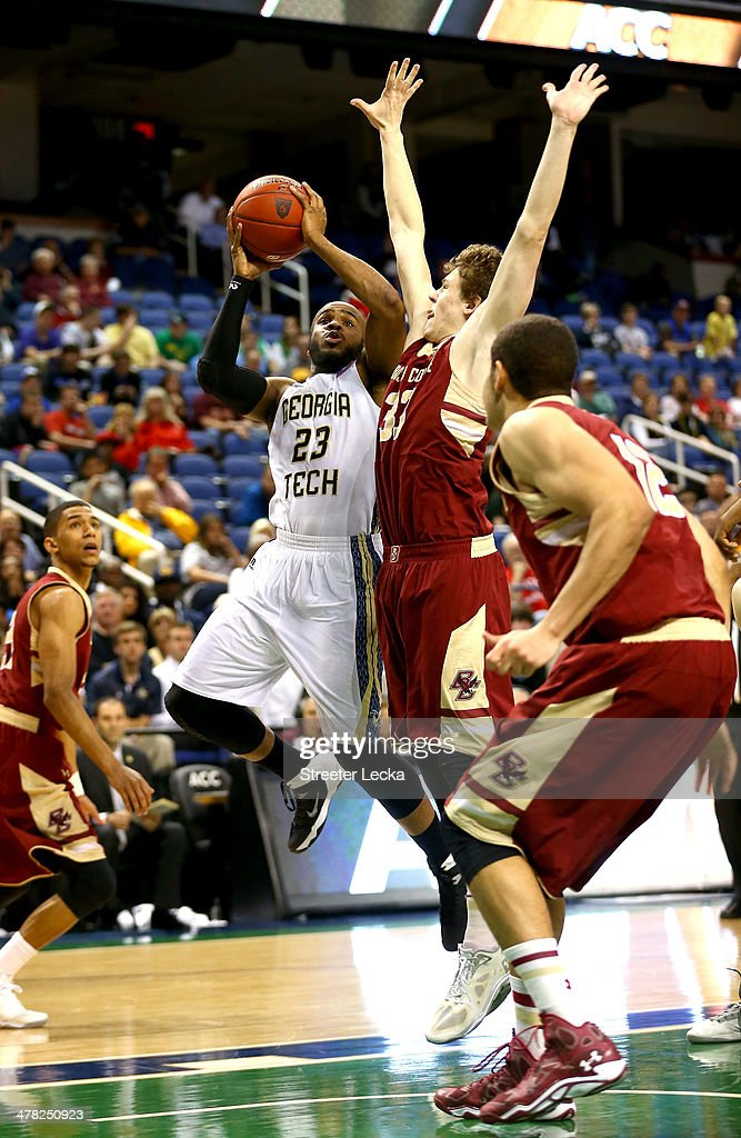 Trae Golden #23 of the Georgia Tech Yellow Jackets drives to the basket against Patrick Heckmann #33 of the Boston College Eagles during the first round of the 2014 Men's ACC Basketball Tournament at Greensboro Coliseum on March 12, 2014 in Greensboro, North Carolina.