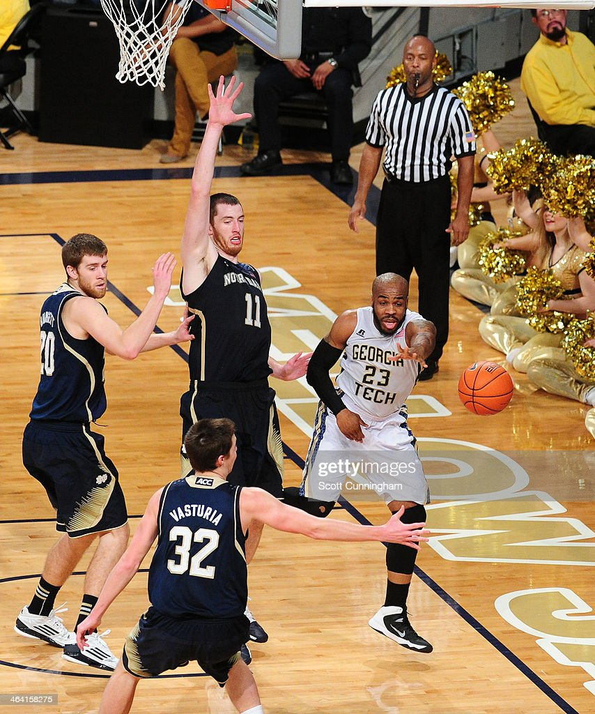 Trae Golden #23 of the Georgia Tech Yellow Jackets passes off against Garrick Sherman #11 of the Notre Dame Fighting Irish at McCamish Pavilion on January 11, 2014 in Atlanta, Georgia. Photo by Scott Cunningham/Getty Images)