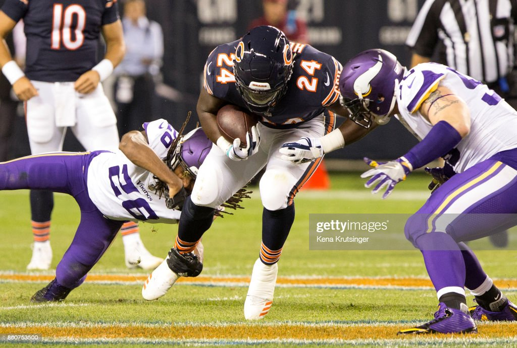 Trae Waynes #26 of the Minnesota Vikings attempts to tackle Jordan Howard #24 of the Chicago Bears in the first quarter at Soldier Field on October 9, 2017 in Chicago, Illinois. The Minnesota Vikings defeated the Chicago Bears 20-17.