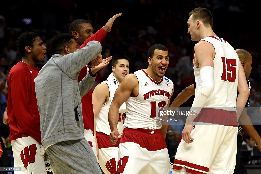 Traevon Jackson celebrates with Sam Dekker of the Wisconsin Badgers in the second half while taking on the North Carolina Tar Heels during the West...