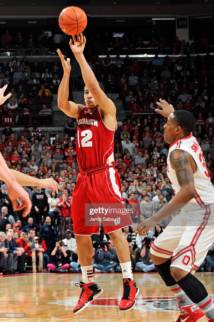 Traevon Jackson #12 of the Wisconsin Badgers attempts a shot in the first half as Lenzelle Smith, Jr. #32 of the Ohio State Buckeyes defends on January 29, 2013 at Value City Arena in Columbus, Ohio. Ohio State defeated Wisconsin 58-49.