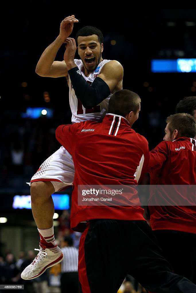 Traevon Jackson of the Wisconsin Badgers celebrates with his team after defeating the Oregon Ducks during the third round of the 2014 NCAA Men's...