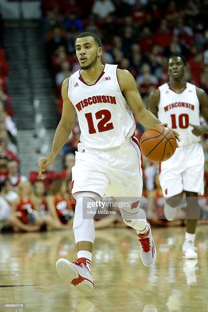 Traevon Jackson of the Wisconsin Badgers dribbles the basketball up the court during the game against the Green Bay Phoenix at Kohl Center on...