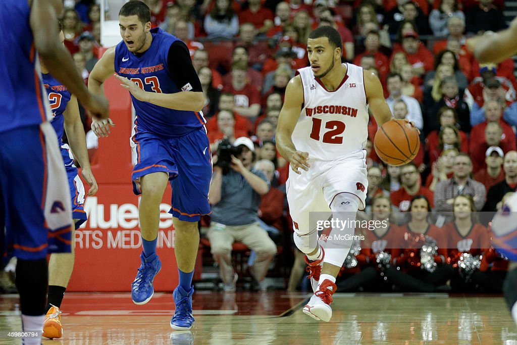 Traevon Jackson of the Wisconsin Badgers dribbles the basketball up the court during the game against the Boise State Broncos at Kohl Center on...
