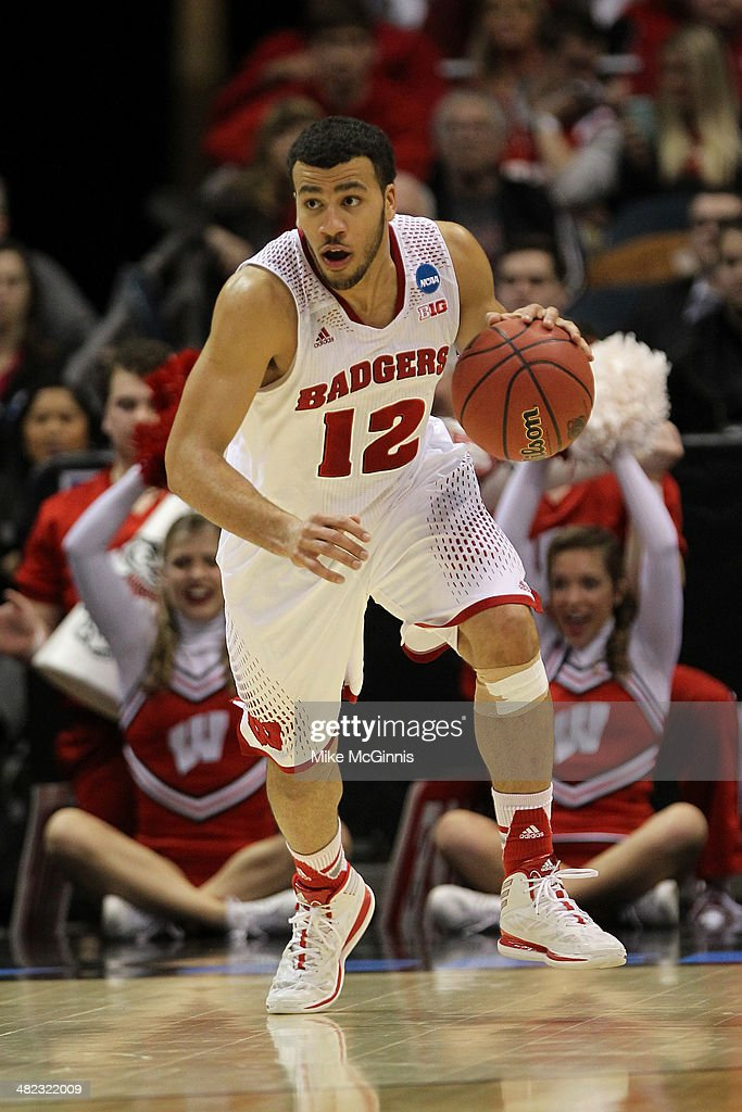 Traevon Jackson of the Wisconsin Badgers dribbles the basketball up the court in the first half against the Oregon Ducks during the third round of...