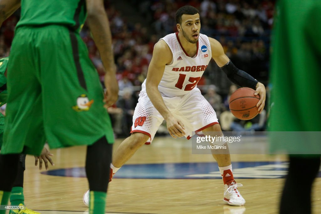 Traevon Jackson of the Wisconsin Badgers dribbles up the court in the first half against the Oregon Ducks during the third round of the 2014 NCAA...