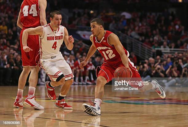 Traevon Jackson of the Wisconsin Badgers drives against Aaron Craft of the Ohio State Buckeyes during the Big Ten Basketball Tournament Championship...