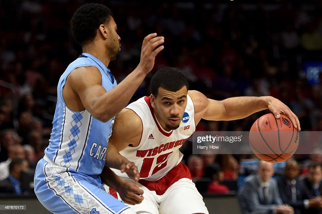 Traevon Jackson of the Wisconsin Badgers drives on Joel Berry II of the North Carolina Tar Heels in the second half during the West Regional...