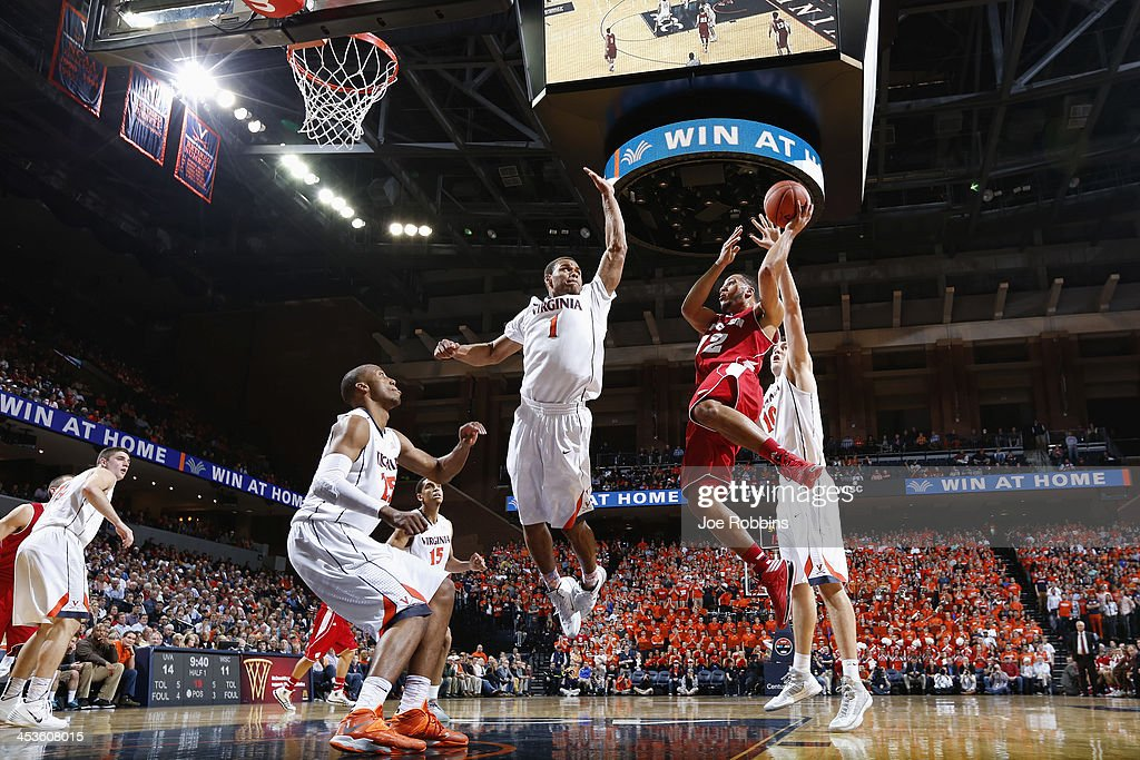 Traevon Jackson #12 of the Wisconsin Badgers drives to the basket against Justin Anderson #1 of the Virginia Cavaliers during the first half of the Big Ten/ACC Challenge game at John Paul Jones Arena on December 4, 2013 in Charlottesville, Virginia.