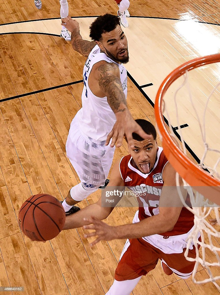 Traevon Jackson of the Wisconsin Badgers drives to the basket against Willie CauleyStein of the Kentucky Wildcats in the second half during the NCAA...