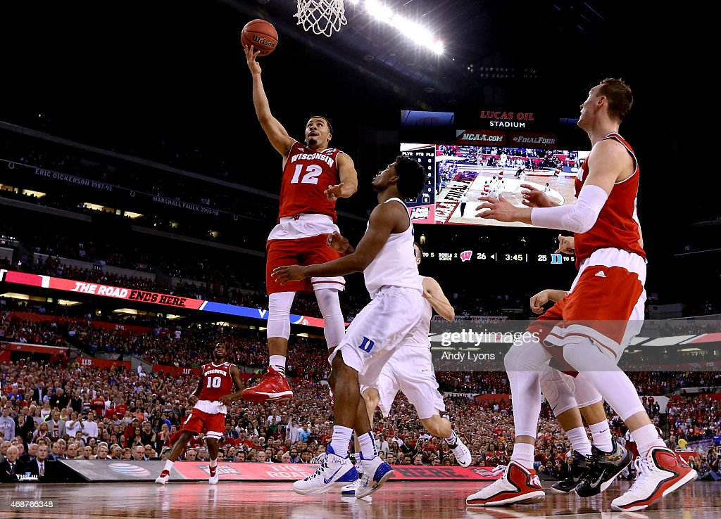 Traevon Jackson of the Wisconsin Badgers drives to the basket against Justise Winslow of the Duke Blue Devils in the first half during the NCAA Men's...