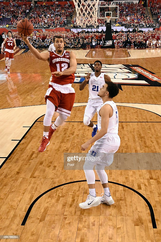 Traevon Jackson of the Wisconsin Badgers drives to the basket against Tyus Jones of the Duke Blue Devils in the first half during the NCAA Men's...