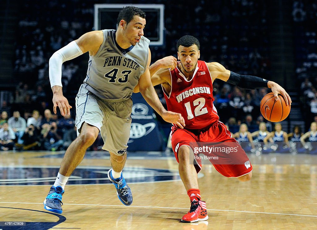 Traevon Jackson of the Wisconsin Badgers drives to the basket against the defense of Ross Travis of the Penn State Nittany Lions during the second...