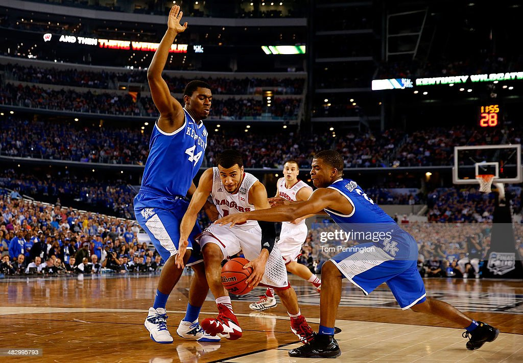 Traevon Jackson of the Wisconsin Badgers drives to the basket as Dakari Johnson and Aaron Harrison of the Kentucky Wildcats defend during the NCAA...