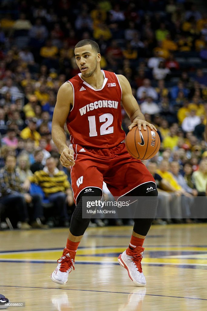 Traevon Jackson of the Wisconsin Badgers drives to the hoop during the game against the Marquette Golden Eagles at BMO Harris Bradley Center on...