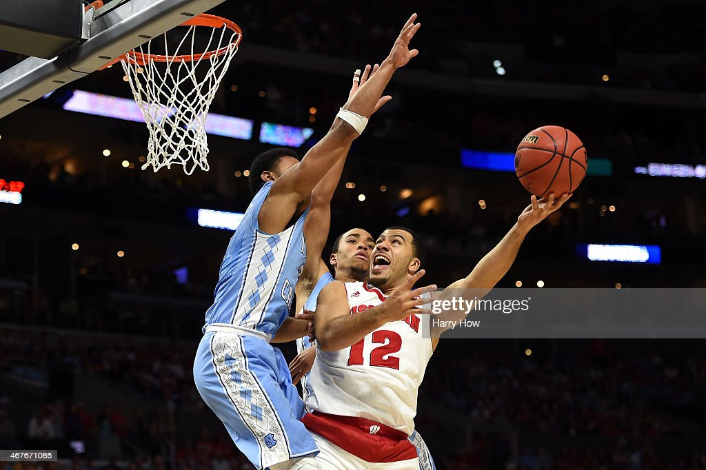 Traevon Jackson of the Wisconsin Badgers goes up for a shot against Joel Berry II of the North Carolina Tar Heels in the second half during the West...