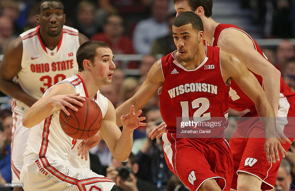 Traevon Jackson #12 of the Wisconsin Badgers guards Aaron Craft #4 of the Ohio State Buckeyes as Evan Ravenel #30 of the Buckeyes watches from behind during the Big Ten Basketball Tournament Championship game at United Center on March 17, 2013 in Chicago, Illinois.