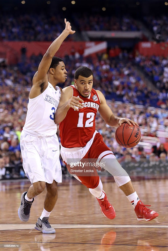Traevon Jackson of the Wisconsin Badgers handles the ball against Tyler Ulis of the Kentucky Wildcats in the second half during the NCAA Men's Final...