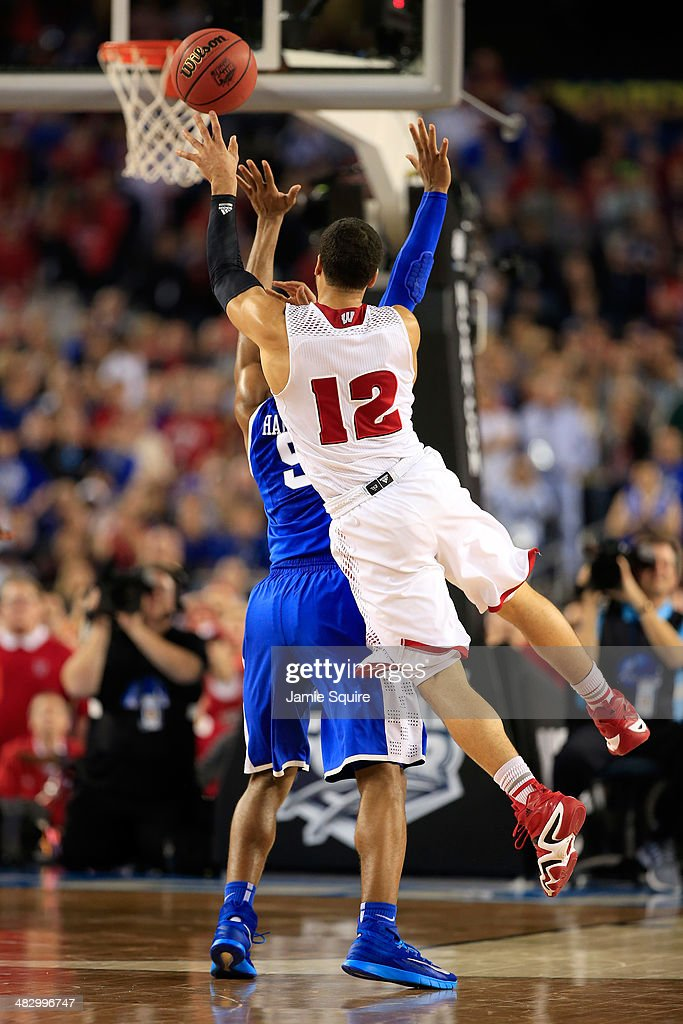 Traevon Jackson of the Wisconsin Badgers is fouled by Andrew Harrison of the Kentucky Wildcats during the NCAA Men's Final Four Semifinal at ATT...