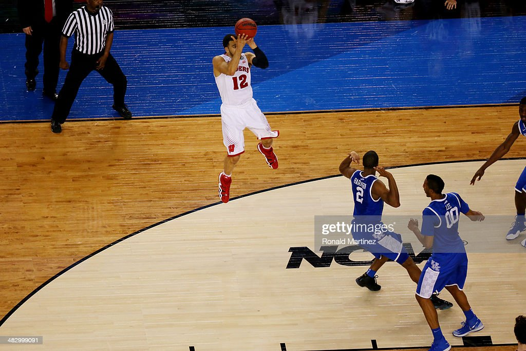 Traevon Jackson of the Wisconsin Badgers misses a shot at the buzzer against the Kentucky Wildcats during the NCAA Men's Final Four Semifinal at ATT...