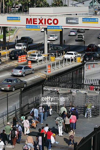 Traffic and pedestrians enter Mexico from the US at the San Ysidro border crossing the world's busiest on June 27 2008 in Tijuana Mexico With the...