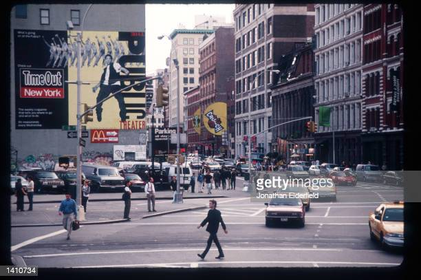 Traffic and pedestrians pass through the intersection of East Eighth Street Lafayette Street and Astor Place in the East Village June 1 1998 in New...