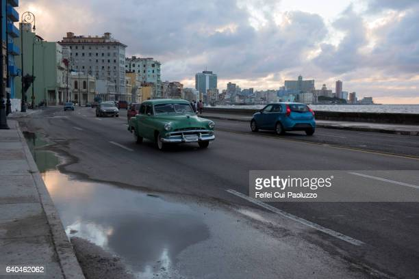 Traffic and reflection at street of Malecon Havana in Cuba