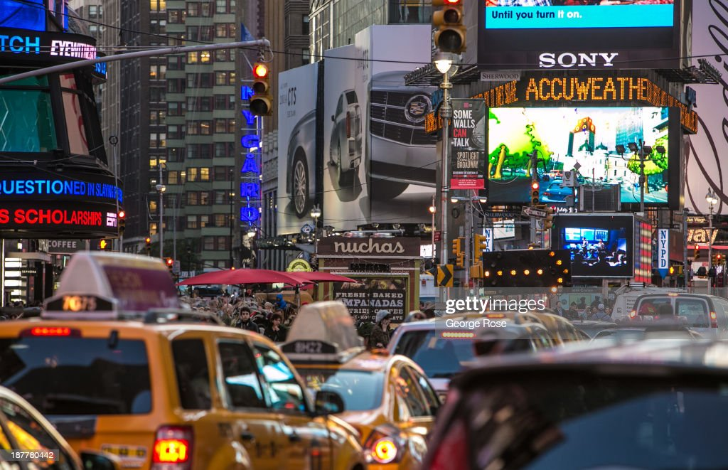 Traffic and tourists jam Broadway and 7th Avenue in Times Square on October 23 2013 in New York City With a full schedule of conventions and major...