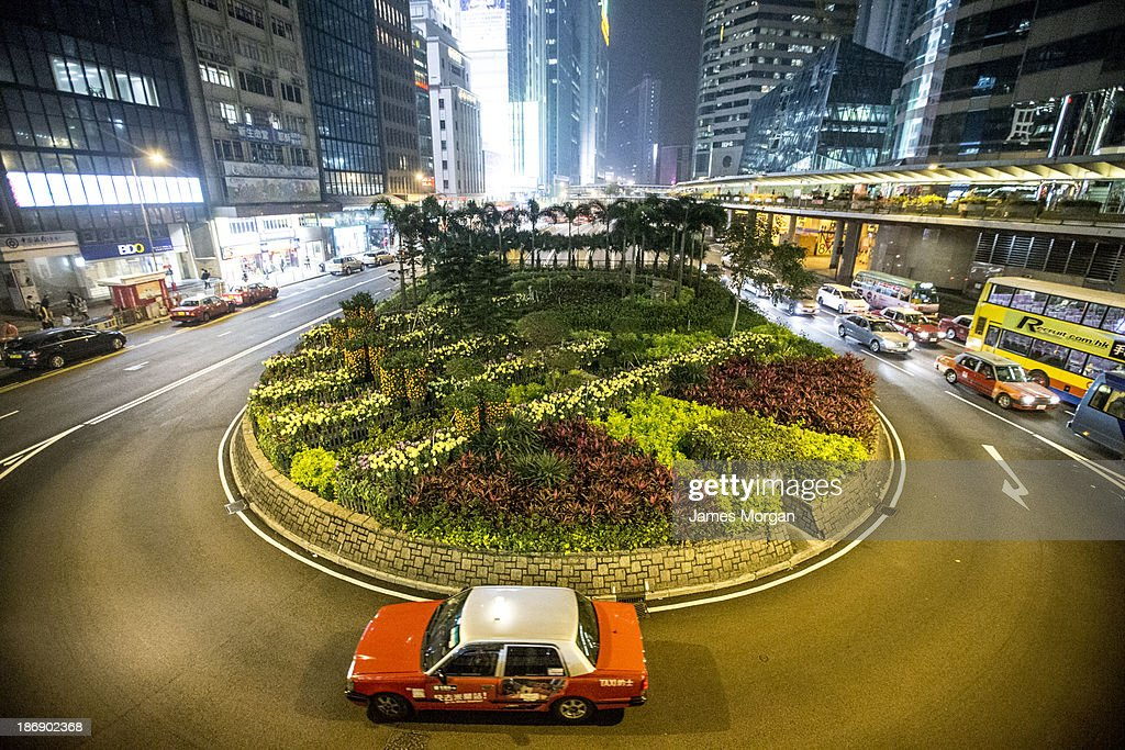 Traffic around a planted roundabout in city centre
