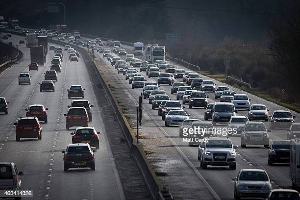 Traffic backs up behind a convoy transporting the fuselage and other parts of a Boeing 747 along the M4 motorway on February 14 2015 near Bristol...