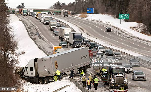 Traffic backs up behind a tractor trailer jackknifed over guardrails in the southbound lane of the Maine Turnpike just south of exit 42 in...
