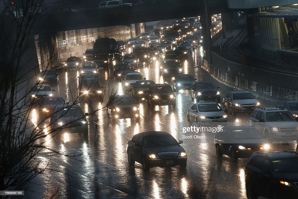 Traffic backs up near a flooded section of the Kennedy Expressway on April 18, 2013 in Chicago, Illinois. Thunderstorms dumped up to 5 inches of rain on parts of the Chicago area overnight, closing sections the Edens, Eisenhower and Kennedy expressways, which lead to and from downtown, during the morning rush.