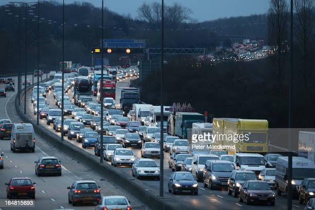 Traffic backs up on the M25 motorway south of London on March 28 2013 near Leatherhead England Up to one million Britons are expected to leave for...