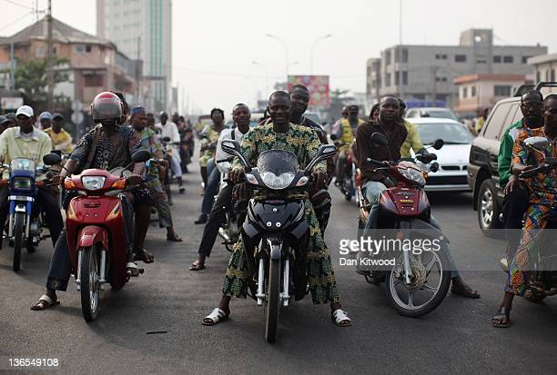 Traffic builds up at rush hour on January 6 2012 in Cotonou Benin Much of Cotonou's hectic traffic comprises of motorcycles and scooters The primary...