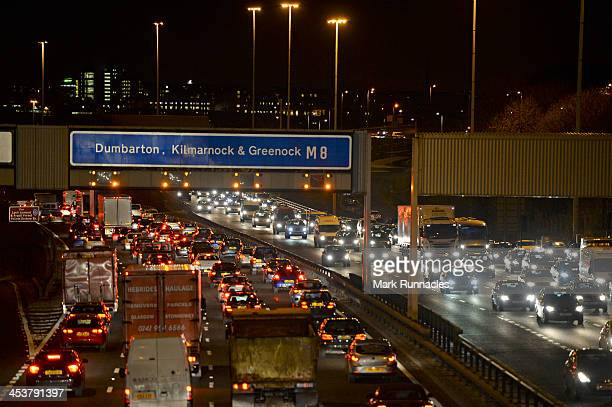 Traffic builds up on the M8 during rush hour as the temperature starts to drop on December 5 2013 in Glasgow Scotland Parts of the UK have suffered...