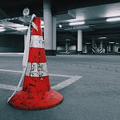 Traffic Cone In Illuminated Empty Parking Lot