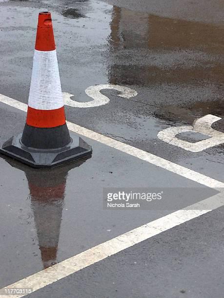 Traffic cone in rain