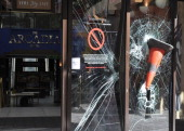 A traffic cone is embedded in the smashed windows of the Arcadia shopping centre on Ealing Broadway following a night of rioting in Ealing on August...