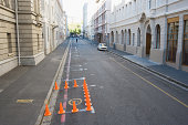 Traffic cones blocking off part of urban street