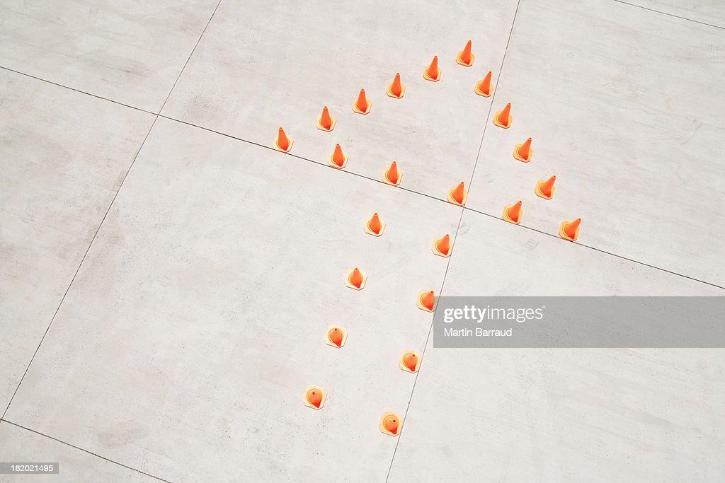 Traffic cones in arrow formation : Stock Photo