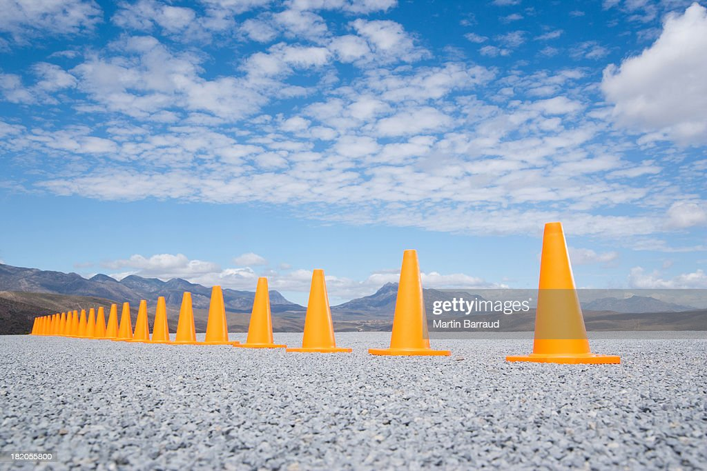 Traffic cones in line outdoors ground level view