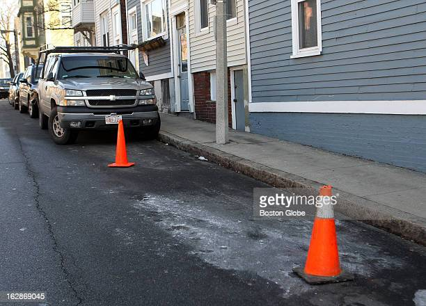 Traffic cones save a parking spot on School Street in Charlestown after a blizzard swept through New England Parking spot savers had to be removed as...