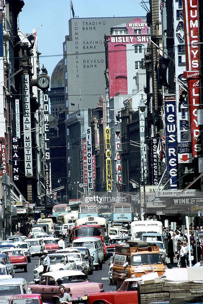 Traffic congestion & advertising signs in George Street, Sydney, 1964 : Stock Photo