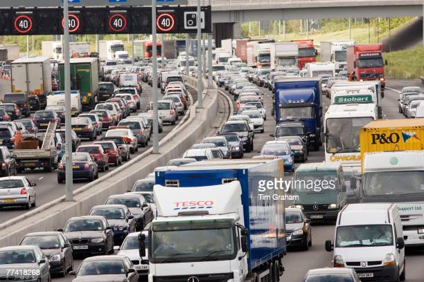 Traffic congestion of cars and trucks at a standstill in both directions on M25 motorway London United Kingdom