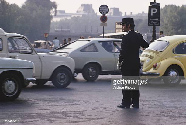 A traffic cop directs traffic at the Place SaintMichel in Paris France July 1975