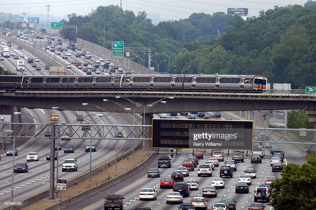 Traffic crawls north out of Atlanta along Interstate 75/85 during rush hour May 9, 2005 in Atlanta, Georgia. According to a new study Atlanta, like many other cities nationwide, is losing its fight against traffic gridlock. The Texas Transportation Institute ranks Atlanta fourth behind Los Angeles, San Francisco and Washington, D.C., for delays per traveler on its roads. Last year, Atlanta was ranked fifth in the study.